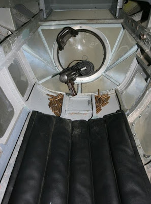 Lower Gunner position in belly hatch of HE 111. The entrance would lie beneath the padding. (From Scale Plastic & Rail website)