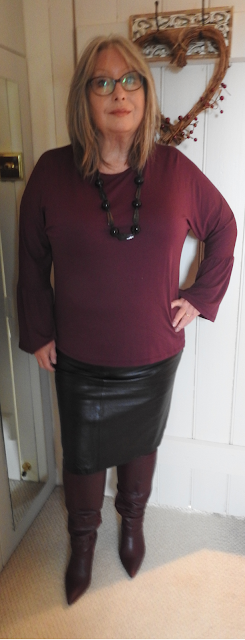 Pouting-Pensioner-berry-boots-fluted-sleeve-top-leather-skirt