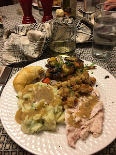 thanksgiving dinner with roasted beets potatoes and brussel sprouts, turkey, and mashed potatoes