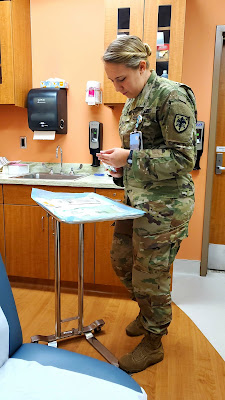Army 2nd Lt. Paige White, a fourth-year medical student, recently on rotation in the procedure room at the Ft. Benning Family Medicine clinic.