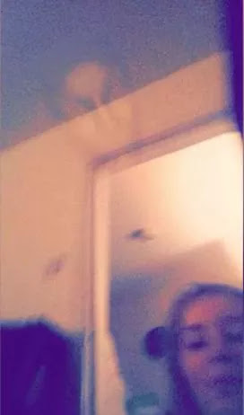 A failed selfie photo that results in the appearance of a ghost that is difficult to explain