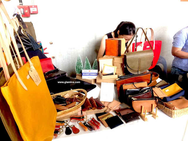 Fourjei booth selling leather bags, key chain, passport holders, make up bags
