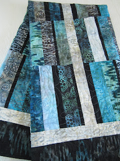 https://www.patchworkmountain.com/collections/quilts/products/batik-handmade-quilt-in-ocean-colors