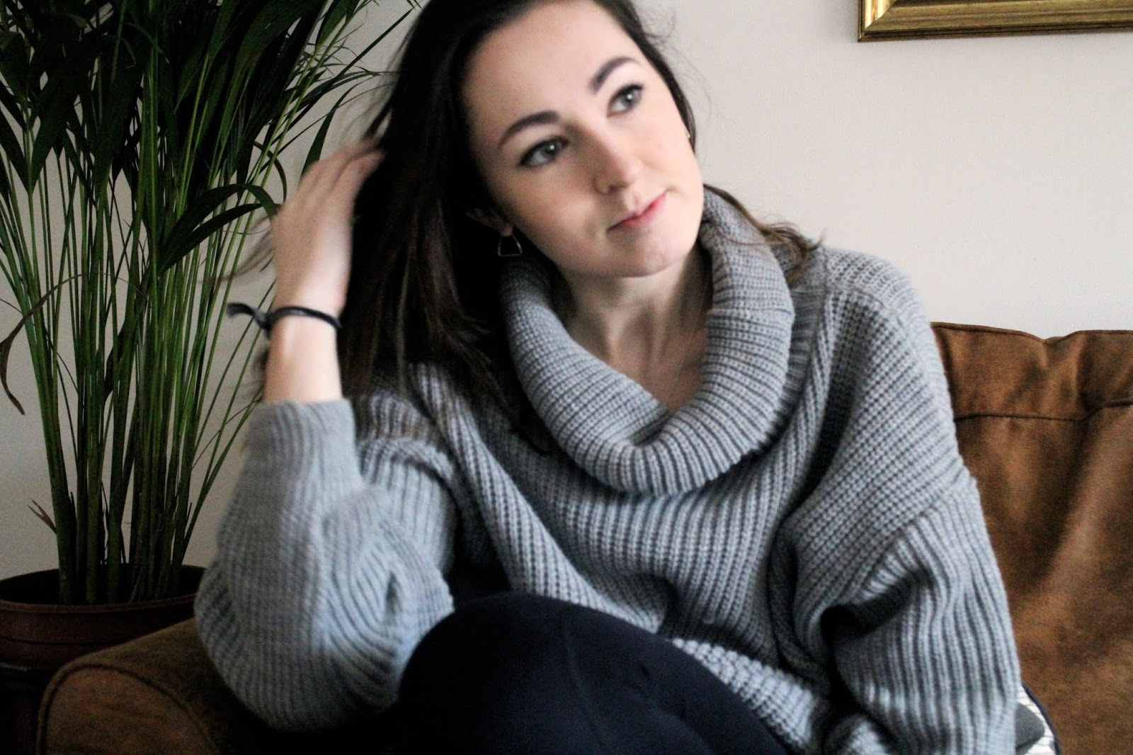 Wearing grey oversized roll neck jumper
