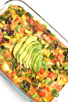 This Mexican Breakfast Casserole is simple to make and is full of flavor with black beans, salsa, bell peppers, avocado and cilantro! www.nutritionistreviews.com