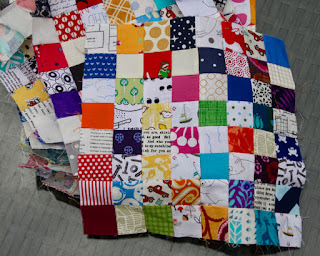 64 squares in a postage stamp quilt block at that fabric feeling