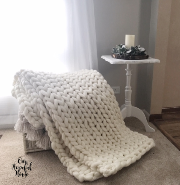 chunky knit throw blanket hygge white painted side table LED candle