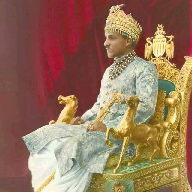 Nawab of Bahawalpur sitting on the 72 kg gold chair.