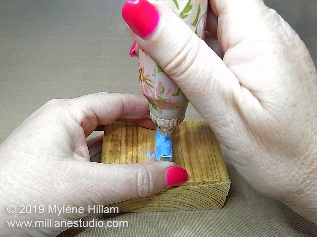 Drilling holes in the resin cabochon.