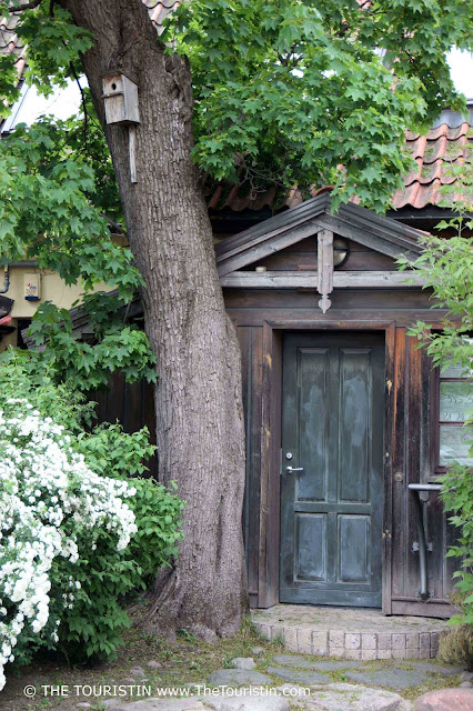 The romantic entrance door of a Wooden House in Užupis in Lithuania The Touristin