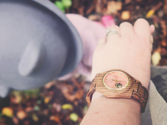 mummy and daughter holding hands on Autumnal walk, mum wears wooden and rose gold watch from jord