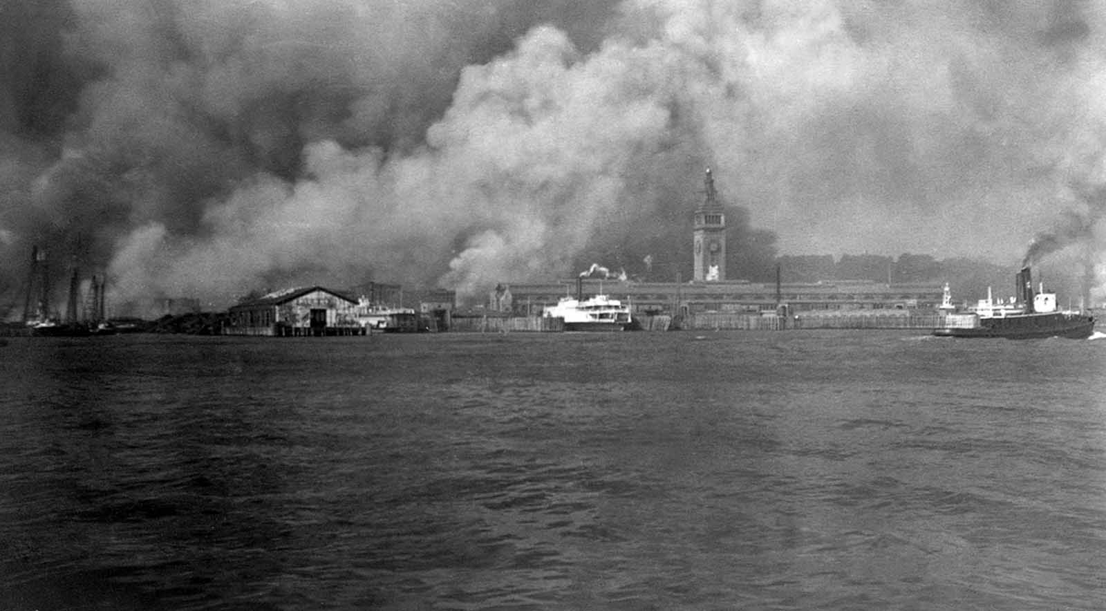 Smoke rises from burning buildings on the waterfront during the fire after the earthquake of 1906 in San Francisco, California.