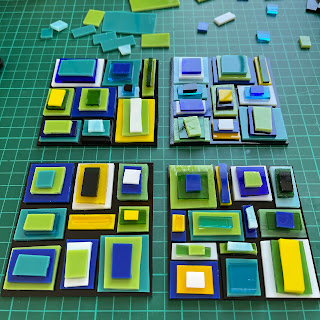Stacked glass coasters ready for the kiln