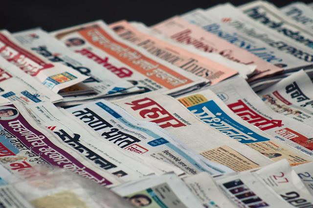 newspapers:Photo by Md Mahdi on Unsplash
