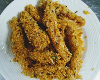 Flour and bread crumbs coated chicken fingers