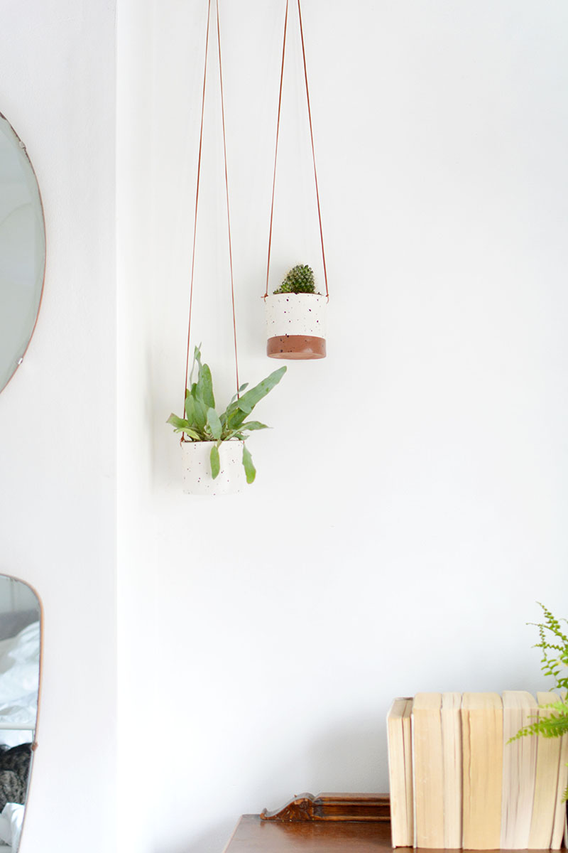 make these DIY planters with a faux ceramic finish with this easy tutorial