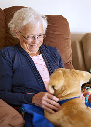 dementia sufferer with new robotic dog