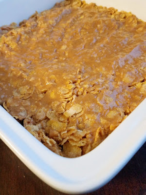 peanut butter corn flake mixture pressed into pan