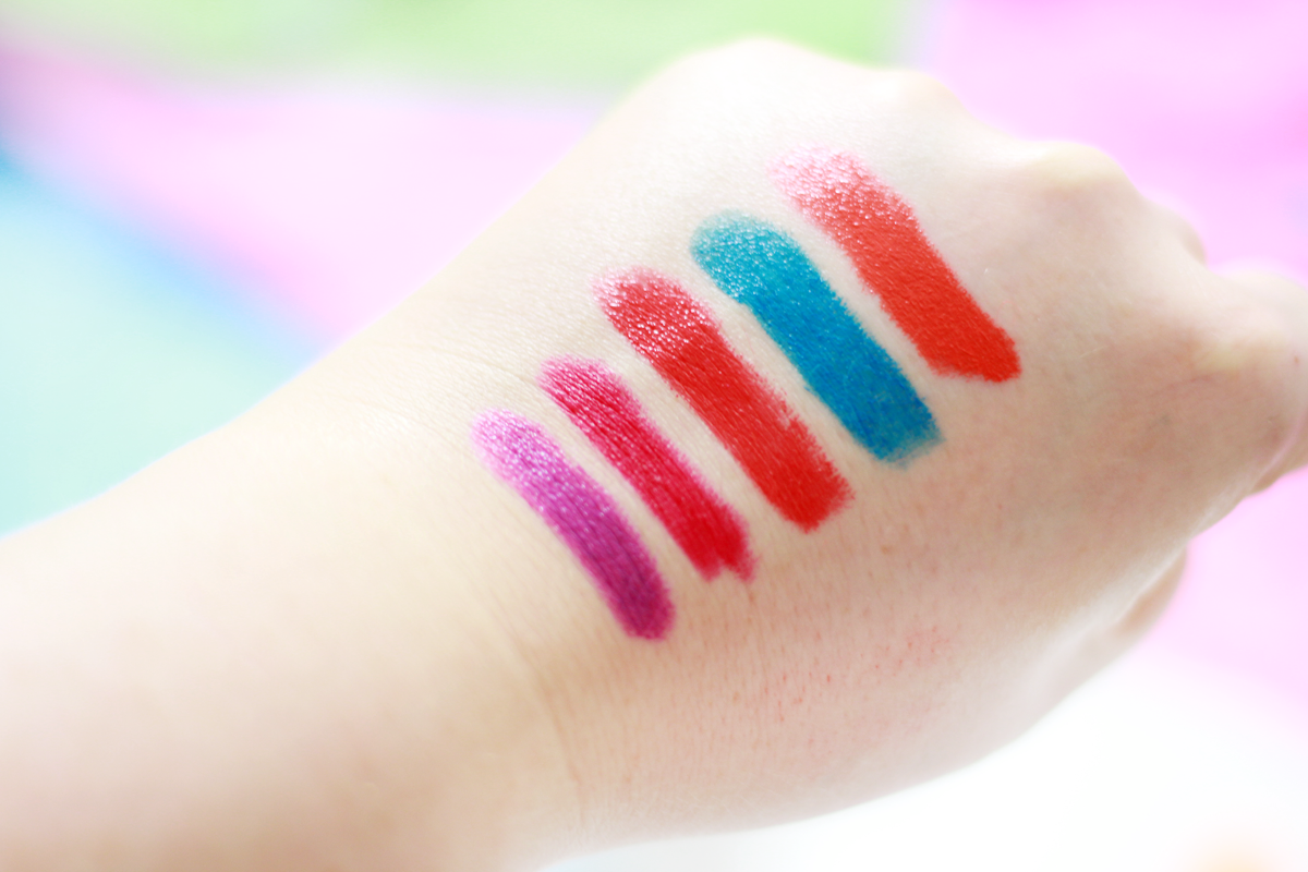An image of Topshop Straight Ace, GOSH Raspberry, Clinique Poppy Pop, Illamasqua Vendetta and MAC Morange Swatches