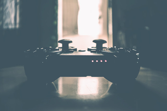 Video game controller, lots of shadows and contrast, stop playing