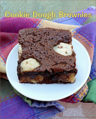 Cookie Dough Brownies, chocolate chip cookie dough is rolled into balls and baked into brownies for the best of both chocolate worlds. | Recipe developed by www.BakingInATornado.com | #recipe #dessert