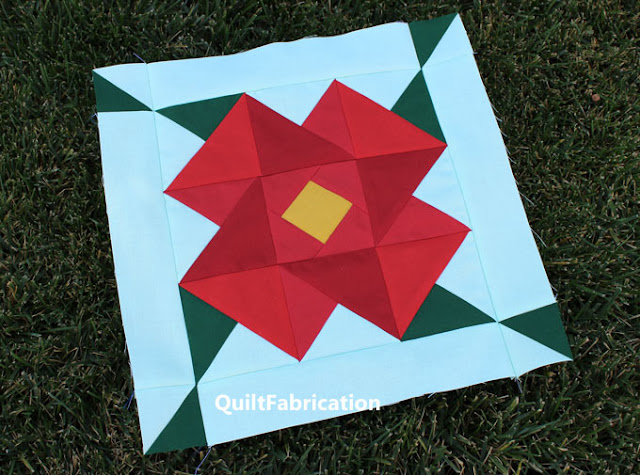 Poinsettia Quilt Block in red and mint by QuiltFabrication