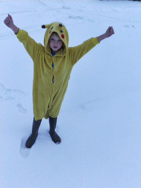 child with autism in pikachu onesie