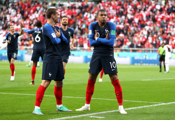 Kylian Mbappe of France celebrates with teammate Antoine Griezmann after scoring his team's first goal during the 2018 FIFA World Cup Russia group C match between France and Peru