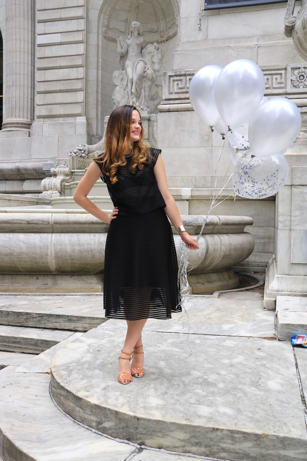 NYC fashion blogger Kat's Fashion Fix wearing an all-black party outfit
