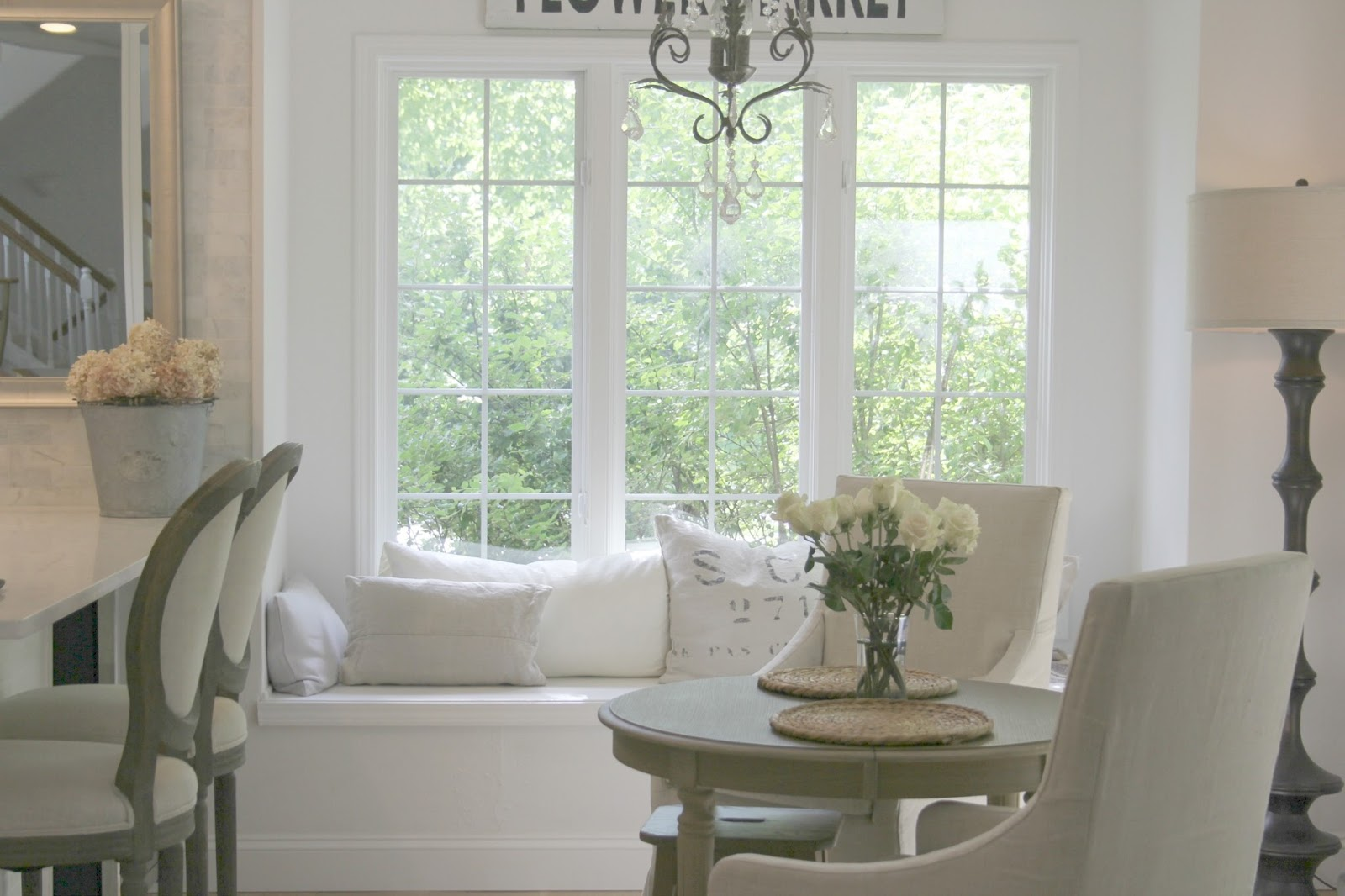 Window seat with linen pillows in European country inspired serene kitchen. Come see more of my home in Hello Lovely House Tour in July. #hellolovelystudio #timeless #tranquil #interiordesign #europeancountry #europeanfarmhouse #simpledecor #serenedecor