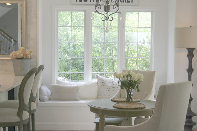 Peaceful and serene kitchen with window seat, neutral decor, and Belgian linen - Hello Lovely Studio