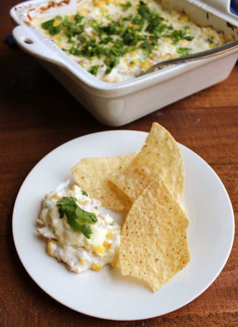 kickin' corn dip on plate with tortilla chips ready to eat