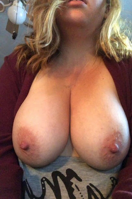Naughty young MILF with huge tits and big nipples out of dress