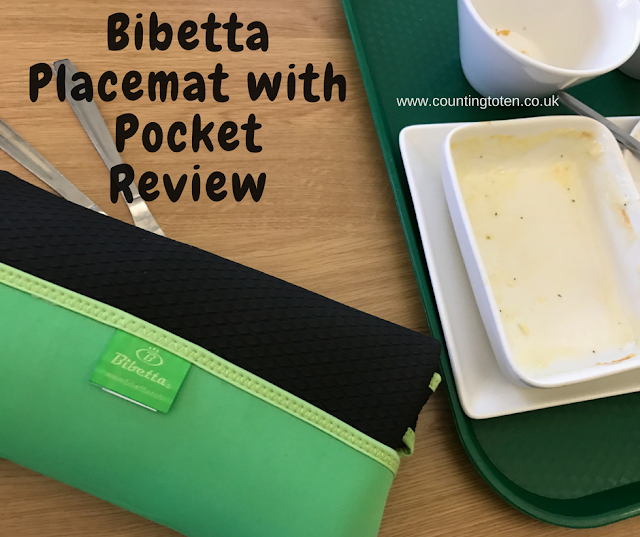 Text saying: Bibetta placemat with pocket review over an image showing the placemat folded up and some empty crockery on a tray