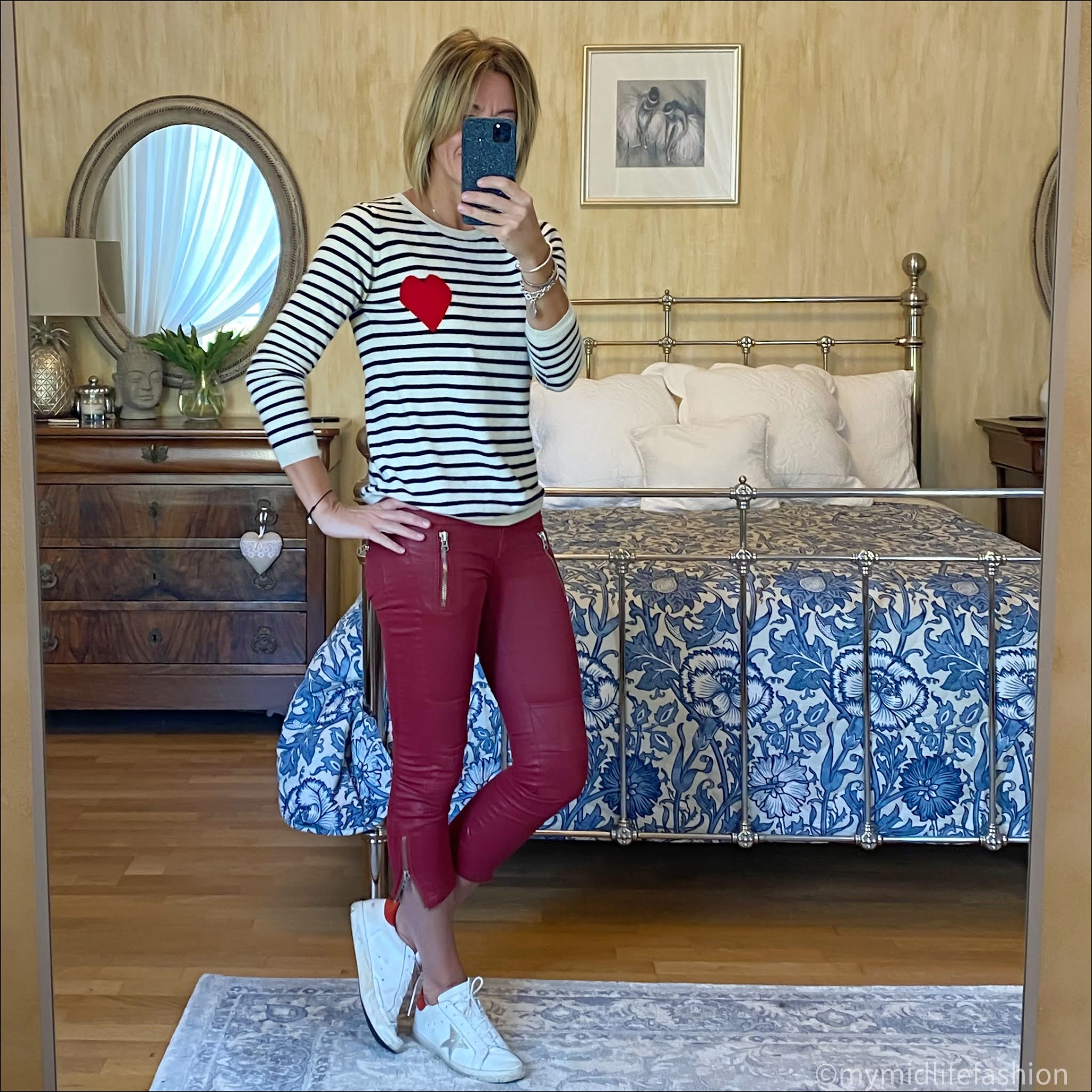 my midlife fashion, Chinti and Parker cream with  navy  striped heart cashmere sweater, golden goose superstar low top leather trainers, Isabel Marant Etoile wax coated biker jeans