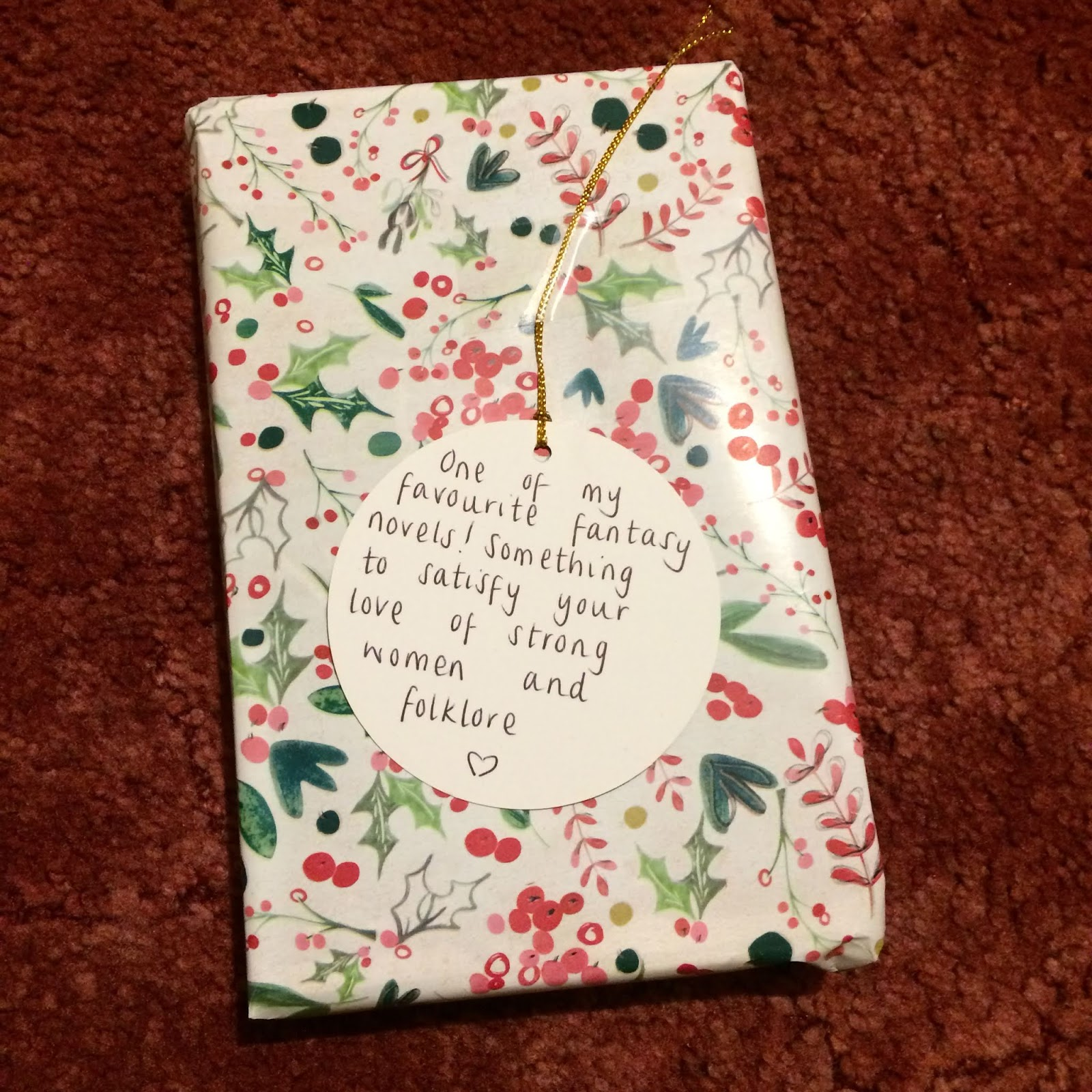 Wrapped present with tag reading, One of my favourite fantasy novels! Something to satisfy your love of strong women and folklore.