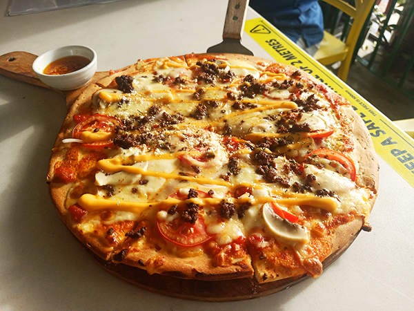 emcaro pizza by Yellow Lantern Cafe