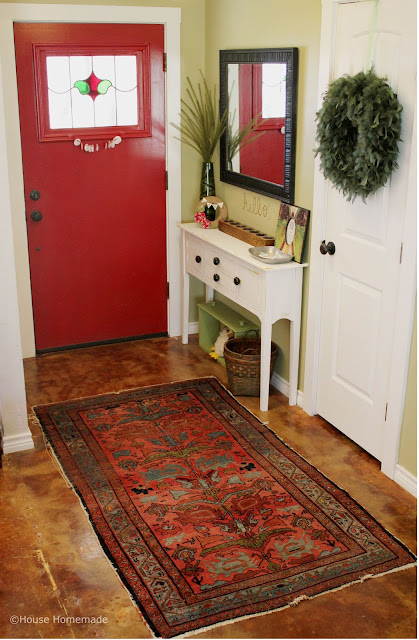 entry way with antique rug
