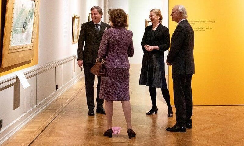 Queen Silvia wore a red-ecru maroon tweed jacket and skirt from Chanel cruise collection