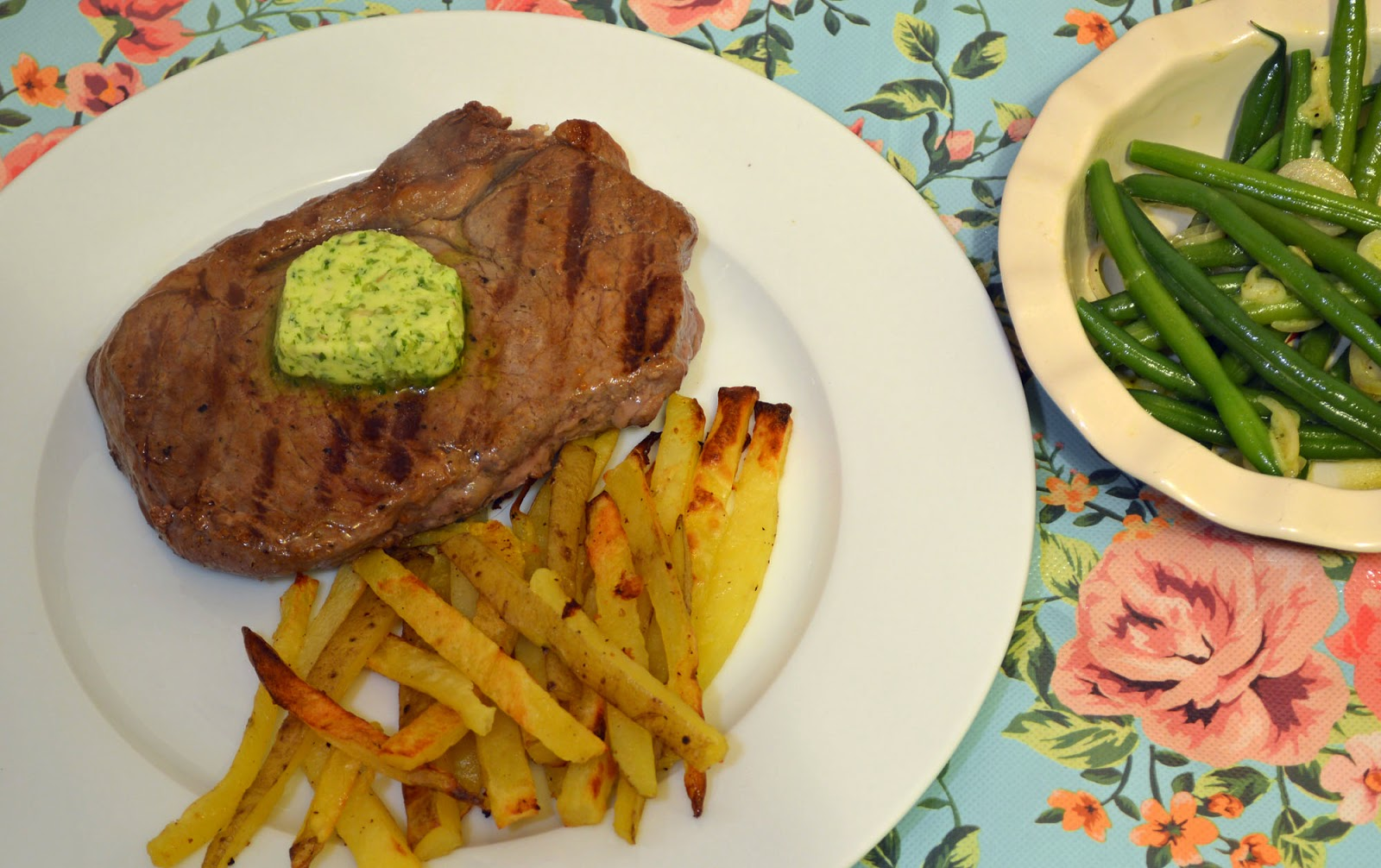 Steak and home made herb butter and home made chips