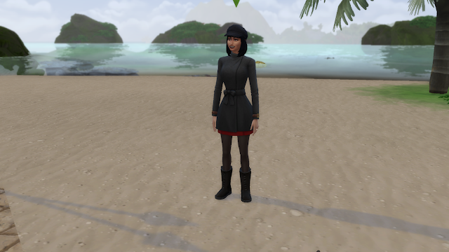 Screen grab of a sim standing on sand in sims 4