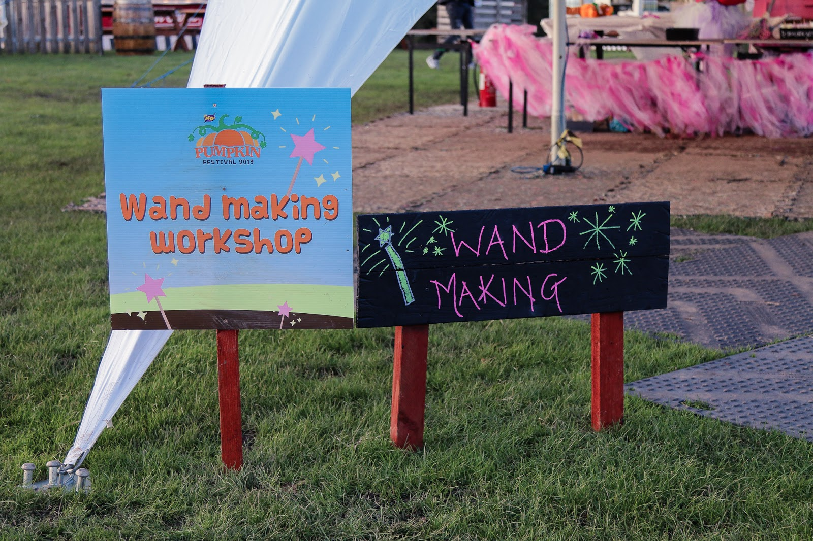 "Close up photo of the sign for the Wand making station - a slate sign with ""wand making"" written in white"