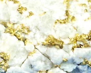 ouro disseminado em quartzo leitoso