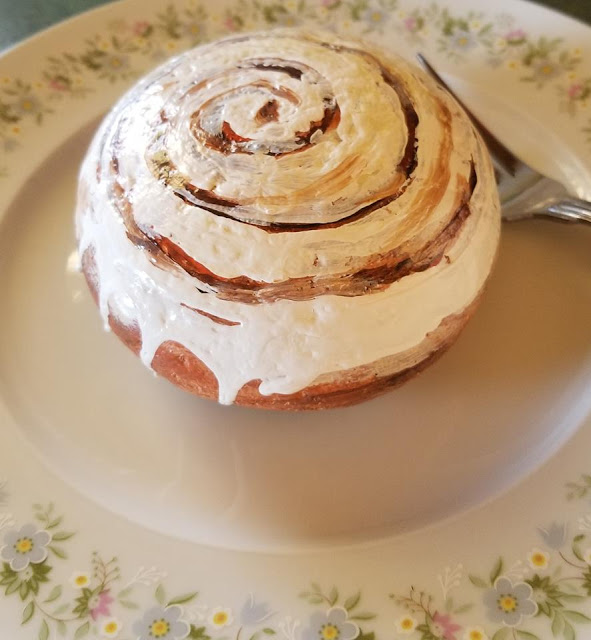 Laura Owen painted this rock that looks like a cinnamon roll