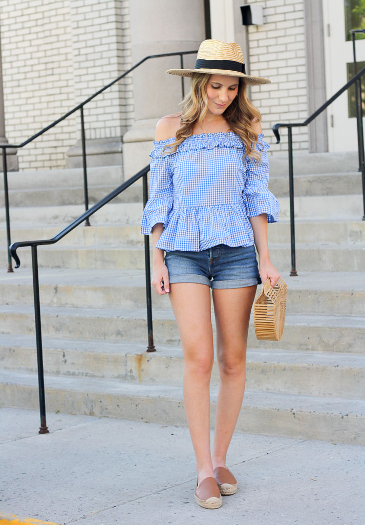 Off the shoulder gingham top and denim shorts.