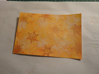 Orange salt background with snowflakes in ink and white mica powder