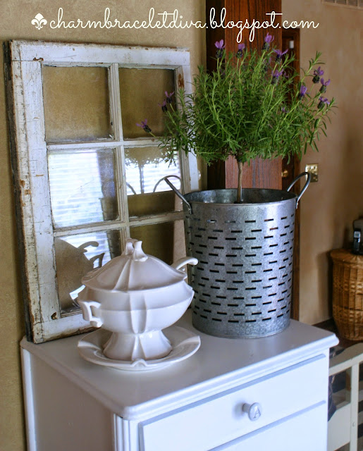 lavender topiary in an olive bucket with an ironstone soup tureen
