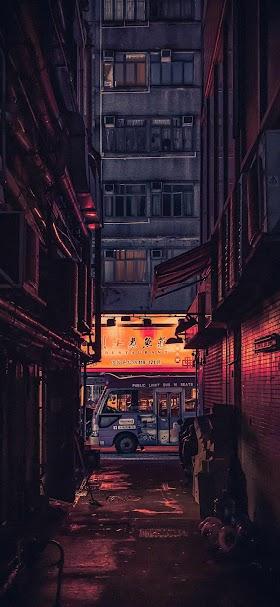 خلفية زقاق الحي الصيني الضيق ينيره ضوء برتقالي خافت