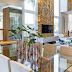 Salas de jantar, tv e estar integradas com decor sofisticado e rústico com pedra morisca gold!