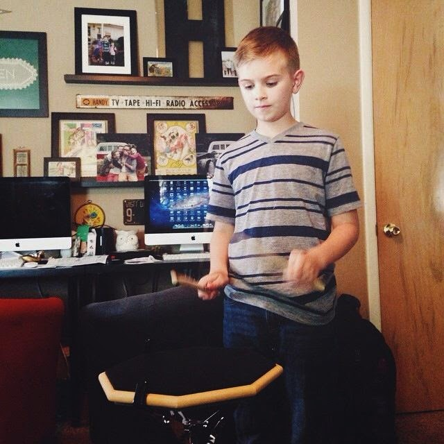 our son with autism practicing the snare drum
